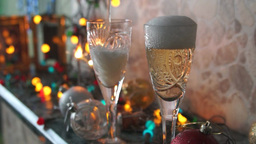 Champagne into crystal glasses Stock Video Footage