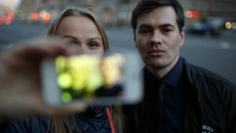 Young couple with phone having fun while taking pi Stock Video Footage