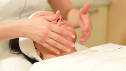 Therapist doing a facial massage at beauty spa Stock Video Footage