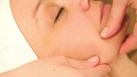Massage treatment of womans face at beauty spa Stock Video Footage