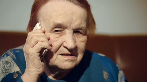 Elderly woman talking on the cell phone Stock Video Footage