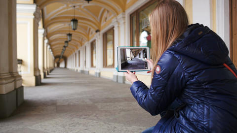 Woman with tablet pc making photo of hall in persp Footage