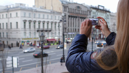 Woman with smartphone taking pictures of city with Stock Video Footage