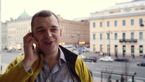 Young excited man talking on the phone outdoor Stock Video Footage