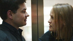 Man and woman talking vividly in lift Footage