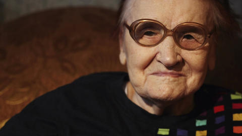 Elderly Woman Putting On Glasses stock footage