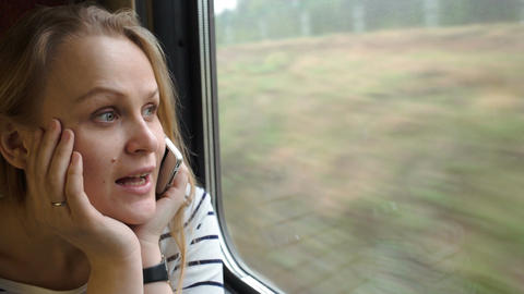 Young woman talking on the phone while traveling b Stock Video Footage