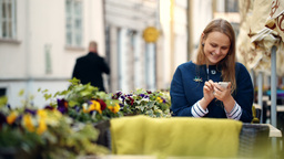 Woman using her smartphone sitting in outdoor cafe Stock Video Footage