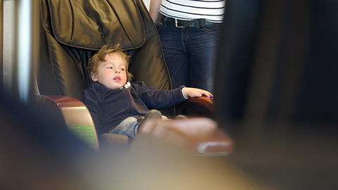 Little child sitting in massage chair Stock Video Footage