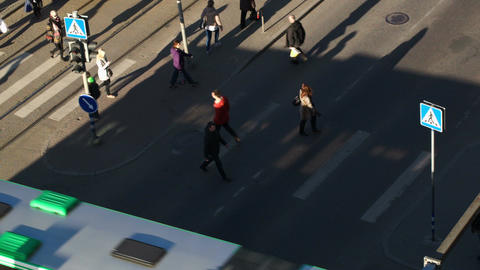 Pedestrians walking across the road in the city Footage