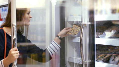 Woman choosing products in the frozen section Footage