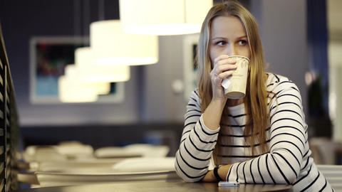 Woman in the cafe drinking tea and waiting for som Footage