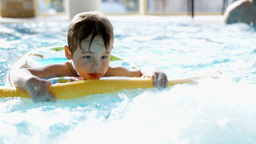 Little boy swimming in the pool with rubber ring Footage