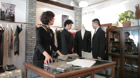Foreigner Shopping In Chinese Men's Boutique stock footage