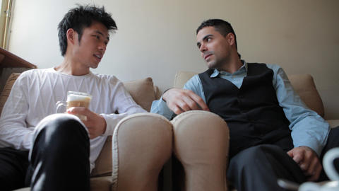 Young Asian and European Friends Having Coffee Stock Video Footage