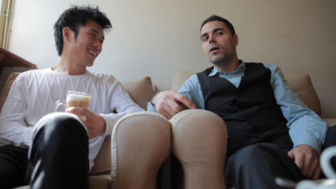 Young Asian And European Friends Having Coffee stock footage