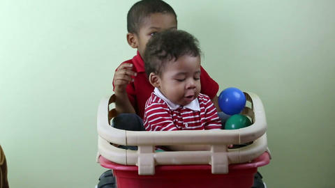Brothers Playing Indoors stock footage