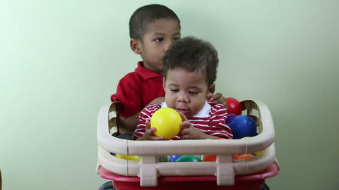Brothers Playing With Multicolored Balls stock footage
