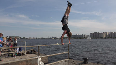 Handstand on the railing. 4K Footage