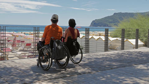 Couple At The Beach With Wheelchairs stock footage