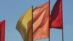 Red and yellow flags are fluttering in the sky Stock Video Footage