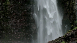 Rock Bottom Of High Waterfall 25fps stock footage