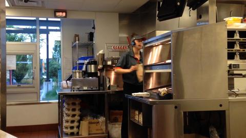 Worker preparing burger for customer Stock Video Footage