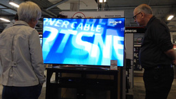 Couple looking for new TV in electronics store Footage