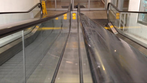 Running down escalators Stock Video Footage