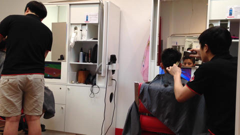 Men having an haircut in a hairdressing salon Footage
