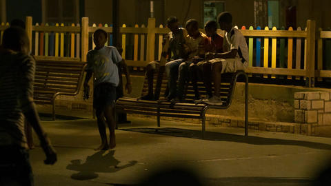 four boys sit on a bench in Cape Verde Stock Video Footage