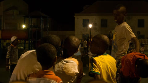 boys playing with one cell phone in Cape Verde Footage