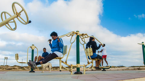 dolly shot of people working out on Cape Verde Stock Video Footage
