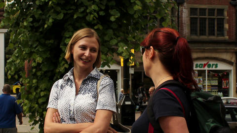 Two Woman Friends Talking On The Street stock footage