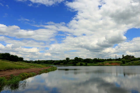 4K. Movement of clouds over the reservoir. Donetsk Stock Video Footage