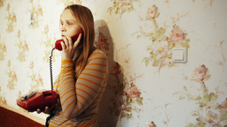 Young woman talking on the phone at home Footage