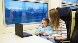 Mother and her son watching movie on laptop in the Stock Video Footage