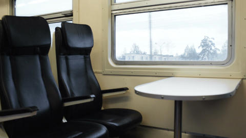 Two empty seats with table in the moving train Footage