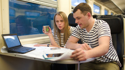 Young people working with plan in the train Stock Video Footage