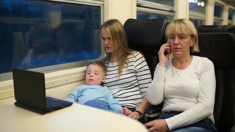 Son with mother watching video on laptop, grandma  Footage
