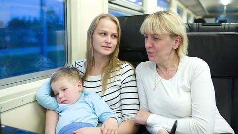 Mother, son and grandmother traveling by train Stock Video Footage