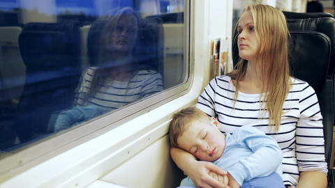 Woman looking out the train window with her son sl Footage