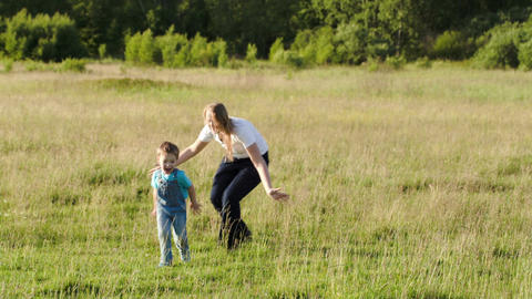 Mother and her son playing bo-peep outdoor Stock Video Footage