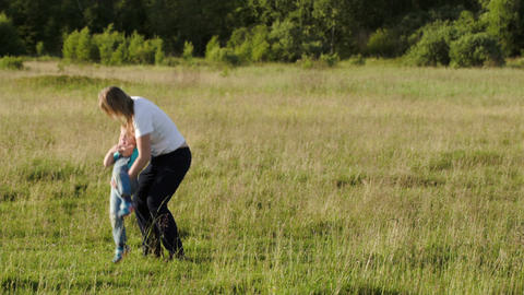 Young mother playing with her son outdoor Footage