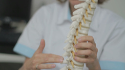 Chiropractor Explaining Spine 29,97fps stock footage