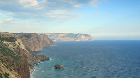 Cloudy sky over the mountains and the sea. Cape Fi Stock Video Footage