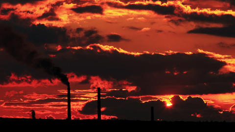 Factory pipe polluting air at sunset. environmenta Footage