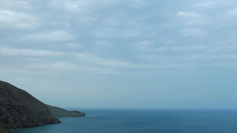 Cloudy sky over the mountains and the sea. Mountai Stock Video Footage