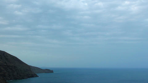 Cloudy sky over the mountains and the sea. Mountai Footage