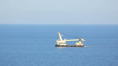 Dredge Floating In The The Sea stock footage